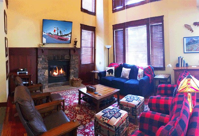 Another Timbers living room with picture windows of golf course